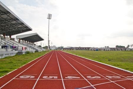 red running tracks in sport stadium\