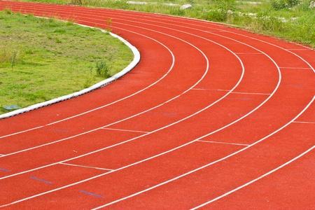 red running tracks in sport stadium photo