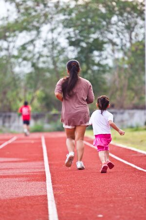 family runs to exercise at thailand photo