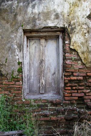 Window in an old brick wall photo