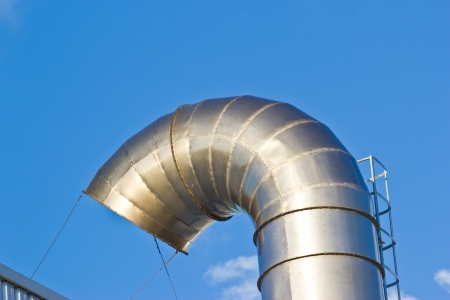 Ventilation pipes of an air conditionon a roof top. Stock Photo