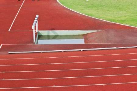 hurdles on the red running track prepared for competition. photo