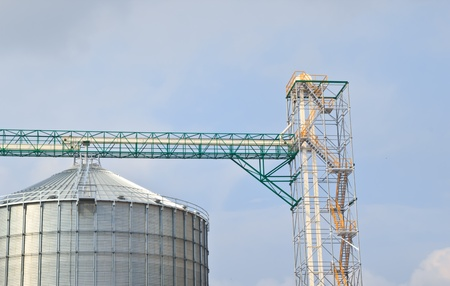 agriculture: Group of silos filled with cereal grain against blue sky. photo