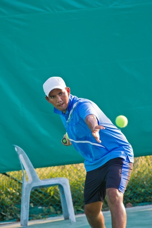 young man practices tennis photo