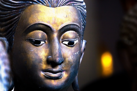 ancient Buddha face, Ayutthaya, Thailand photo
