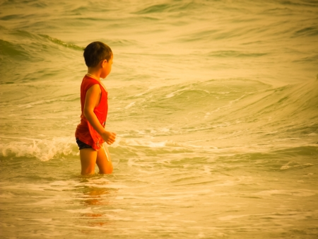 little girl have a good time of resort beach photo