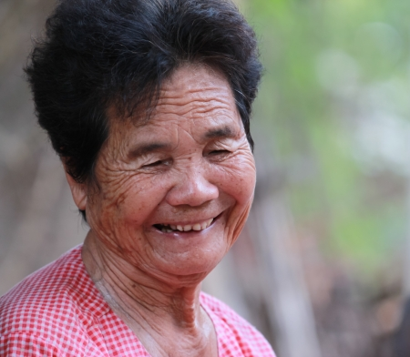 Senior people portrait, happy old woman smiling photo