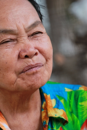 old woman closes ones eyes photo