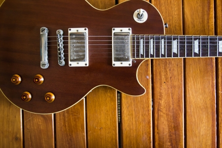 mojo: Vintage top guitar on old wood surface.