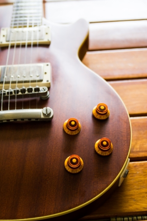 Vintage top guitar on old wood surface. photo