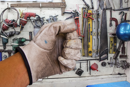 Close up dirty leather gloves in factory photo