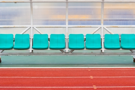 substitution: Coach and reserve benches in a soccer field Stock Photo