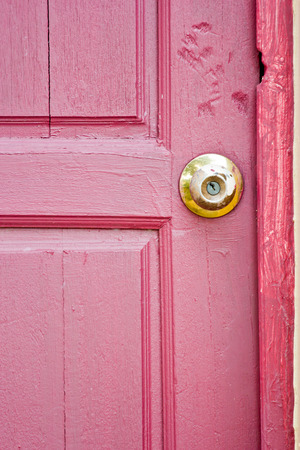 Door knob on red photo