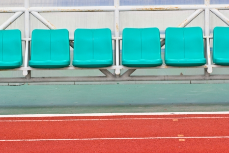 Coach and reserve benches in a soccer field photo