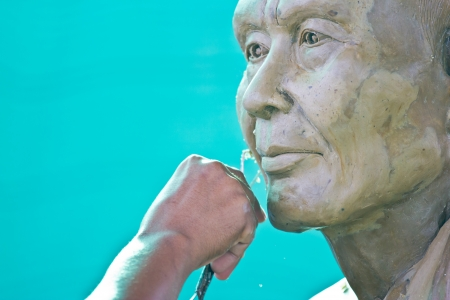 Sculpture Tool  artisan creates the head of a Buddhist monkfestival in thailand photo