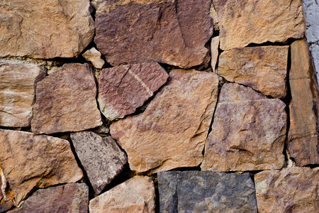 Elegant stone wall from small square parts photo