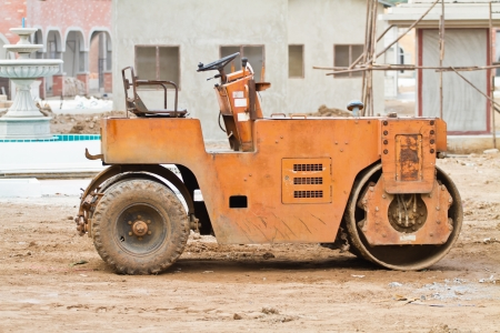 blacktopping: road roller at construction site. Stock Photo