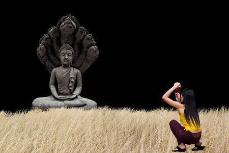 definitive: young woman is taking photos buddha