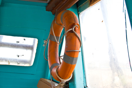 Life Buoy attached to a Wooden Paneled Wall with Plenty of Copy Space photo