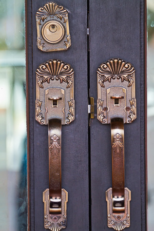 Door handles are made of steel. beautiful pattern. photo