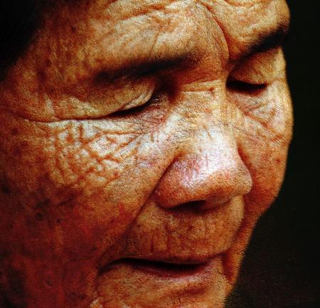 closes eyes: old woman closes ones eyes