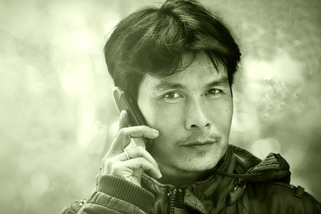 man talking on the phone and smiling photo