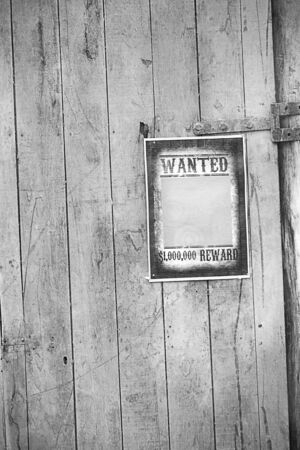 Old western sign, on wooden background. photo