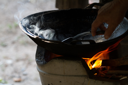 brazier: cook on pan at the charcoal brazier
