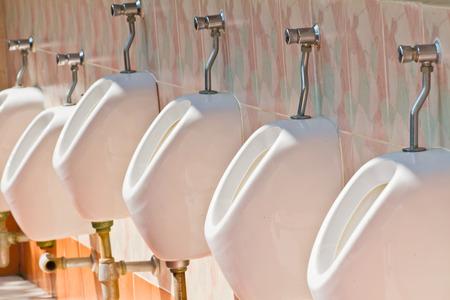 urinal: white urinal for men Stock Photo