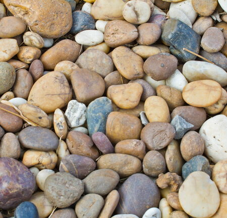 background of round colored sea pebbles photo