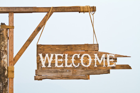 welcome sign hanging on rope photo