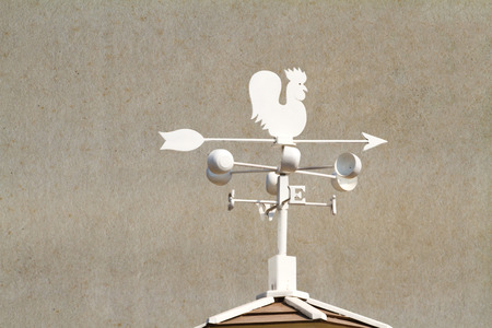 acute angle: Weather vane - cockerel which reflected sun against bright-dark blue sky Stock Photo