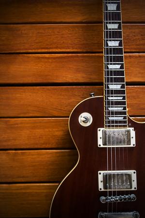 Vintage top guitar on old wood surface.