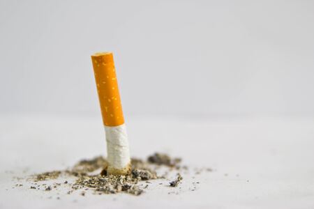 consumed cigarettes on white background photo