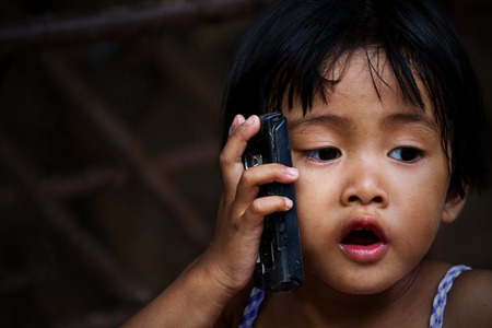 asian girl who talks on the telephone photo
