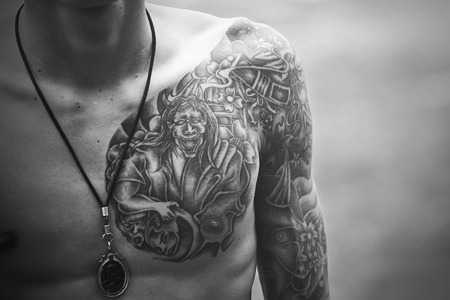Handsome young man with tattoo photo