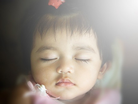 close-up portrait of beautiful sleeping baby photo