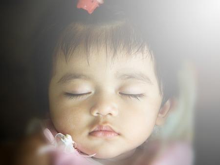 close-up portrait of beautiful sleeping baby photo