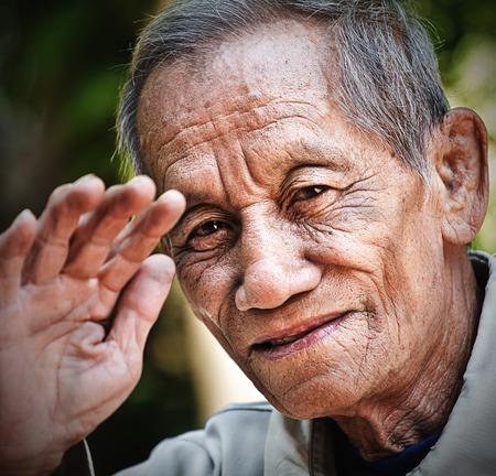 asian old senior man candid portrait photo