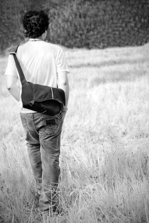 young man walking alone photo