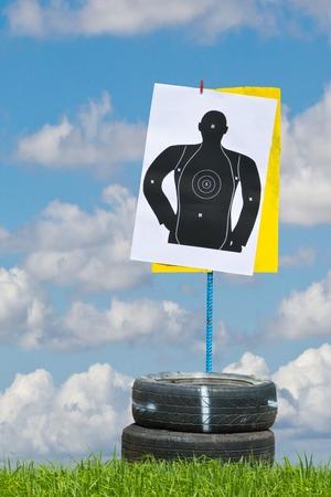 hand with gun shooting target photo