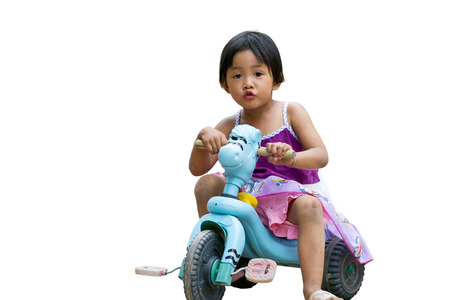 small girl riding bicycle photo