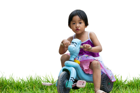 soft pedal: small girl riding bicycle Stock Photo