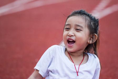 Cheerful girl in sports stadium photo