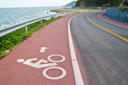 Bicycle sign on the road at beach of thailand photo