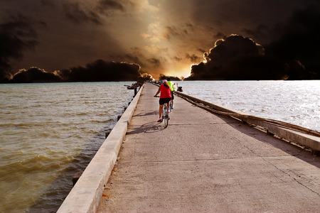 cycling at Jetty in Thai sea photo