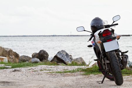 motorcycle traveler on thai sea Stock Photo