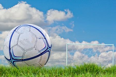 goalpost: goalpost net detail with green grass blur in background sports concepts Stock Photo