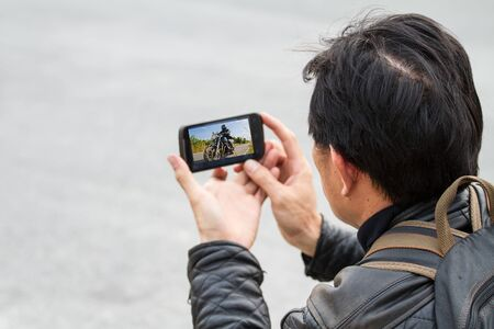 mobile phone camera in male hands   photo