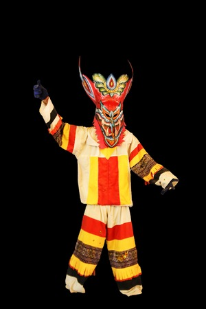 Phi Ta Khon Festival on June in Loei, Thailand. Young people dress in spirit and wear a mask, sing and dance photo
